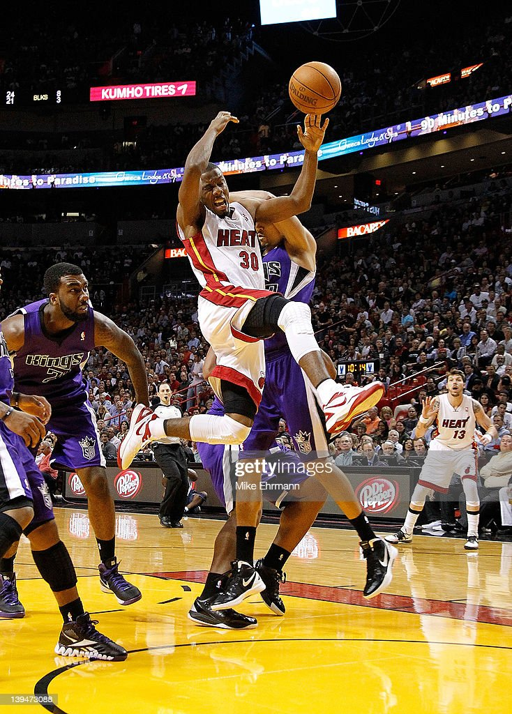 Norris Cole #30 of the Miami Heat is fouled driving to the basket during a game against the Sacramento Kings at American Airlines Arena on February 21, 2012 in Miami, Florida.