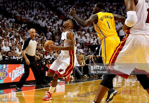 Norris Cole of the Miami Heat is hit in the face by Lance Stephenson of the Indiana Pacers during Game Six of the Eastern Conference Finals of the...
