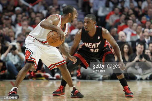 Norris Cole of the Miami Heat plays defense on John Lucas III of the Chicago Bulls during the game on March 14, 2012 at the United Center, Chicago,...