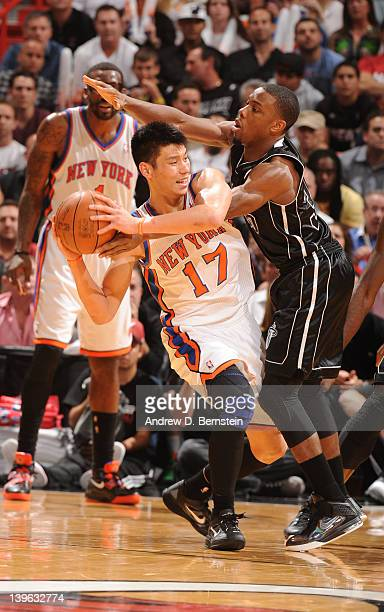 Norris Cole of the Miami Heat reaches in on Jeremy Lin of the New York Knicks for the ball during the game on February 23, 2012 at American Airlines...