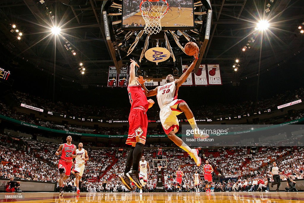 Norris Cole #30 of the Miami Heat shoots a layup against Vladimir Radmanovic #77 of the Chicago Bulls in Game Two of the Eastern Conference Semifinals during the 2013 NBA Playoffs on May 8, 2013 at American Airlines Arena in Miami, Florida.