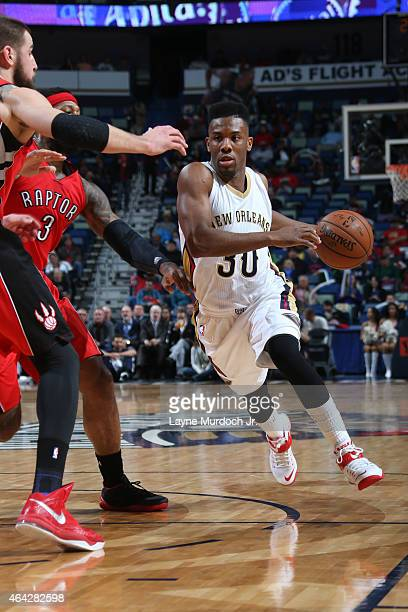 Norris Cole of the New Orleans Pelicans drives to the basket against the Toronto Raptors during the game on February 23 2015 at Smoothie King Center...