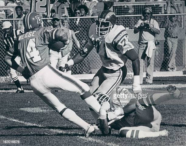 SEP 17 1978 SEP 18 1978 Norris Weese of the Broncos evades Woodrow Lowe and Fred Dean of the Chargers