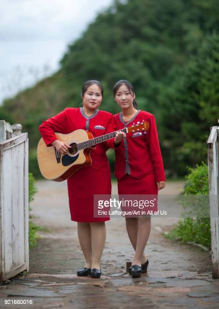 Norrth Korean young women with a guitar North Hamgyong Province Jung Pyong Ri North Korea on September 17 2011 in Jung Pyong Ri North Korea