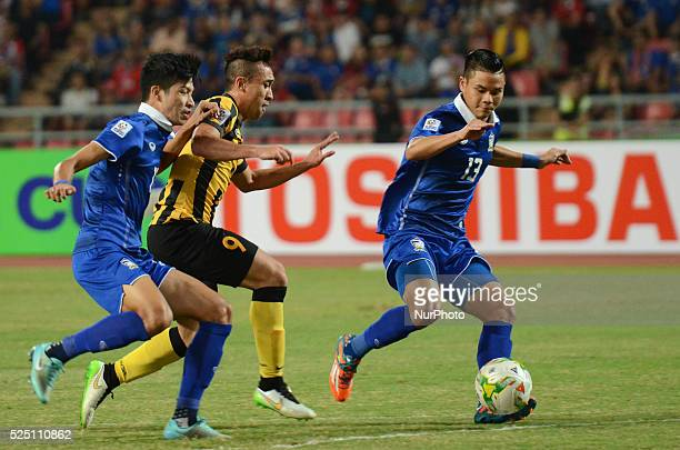 Norshahrul Idlan Talaha of Malaysia is close down by Thailand players during the AFF Suzuki Cup 2014 final round 1st leg Thailand Malaysia at...