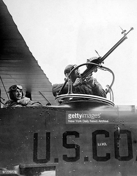 A Norstrand of the Coast Guard aims a Lewis gun skyward explaining the gun's use in enabling aircraft to cope with rum runners who try to smuggle...