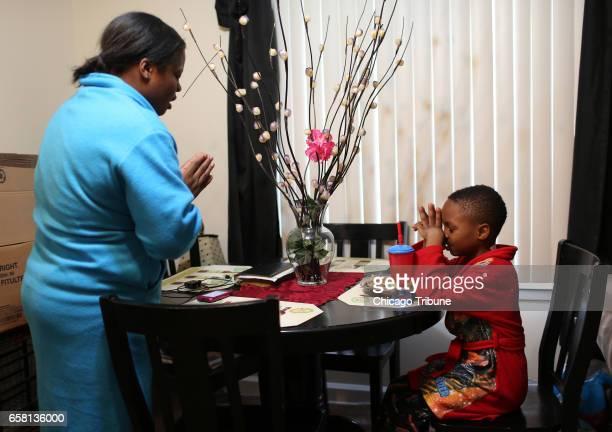 Nortasha Stingley mother of Marissa Simone BoydStingley killed last June 25th and her sixyearold son Levell Watts Jr pray before he eats his pancakes...