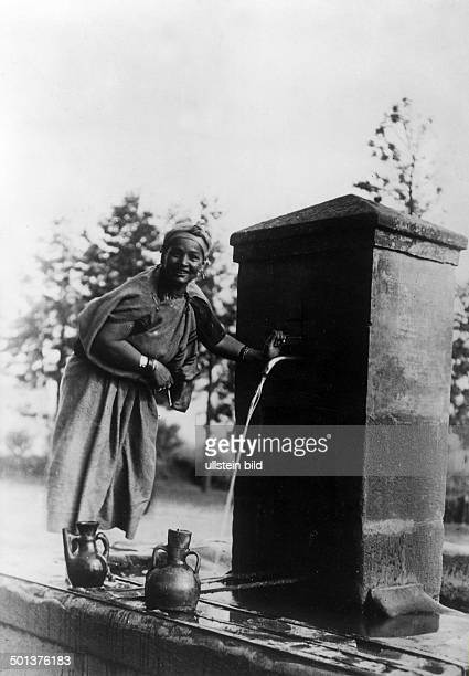Kabylian woman getting water from a well probably in the 1910s