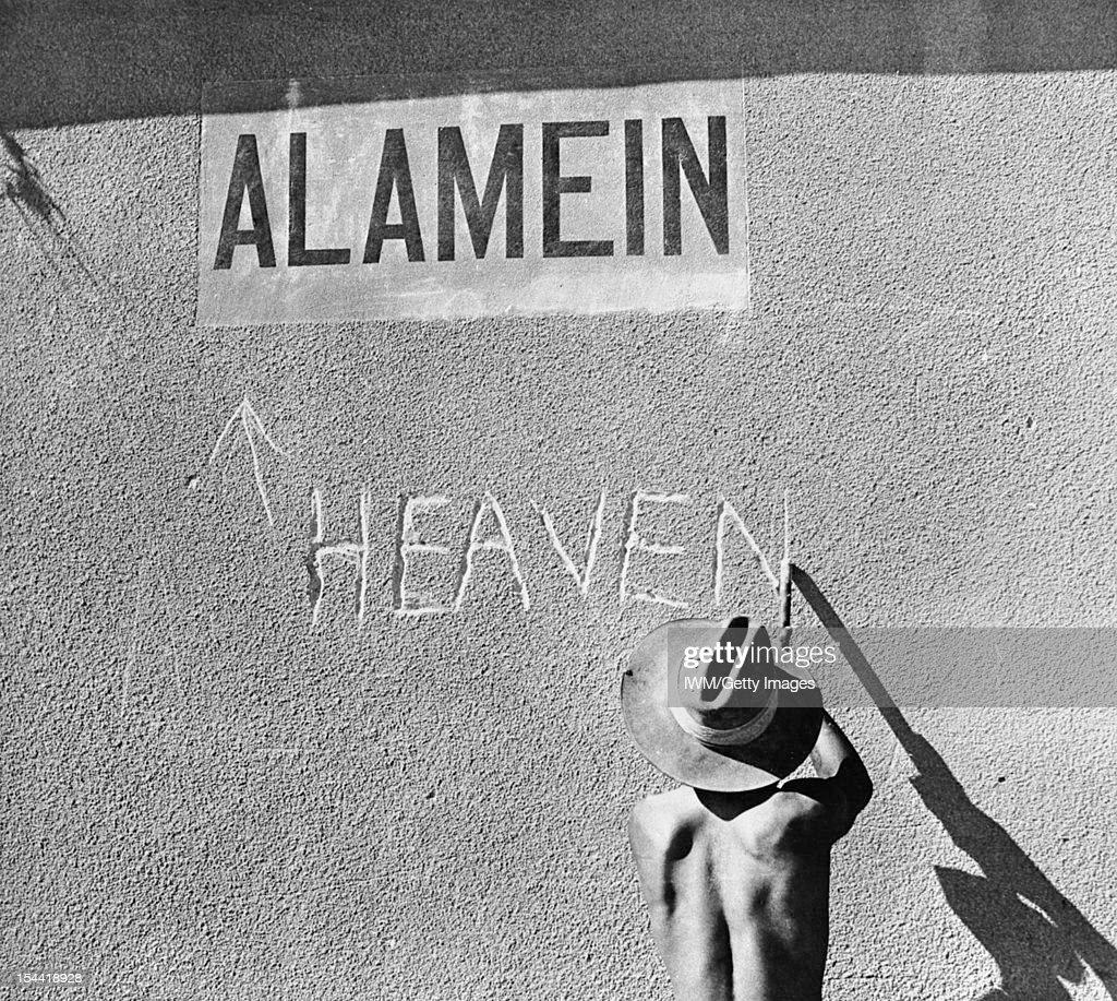 North Africa. Australian Troops, An Australian re-christens Alamein station, 14 August 1942.