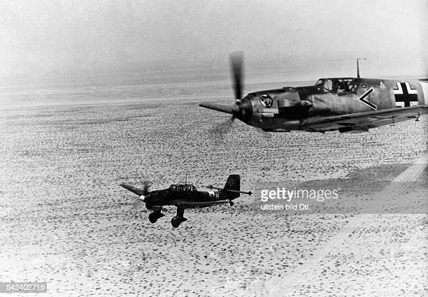 2WW North Africa war theater german Luftwaffe Feb41May43Besiege of Tobruk Divebomber 'Stuka' escorted by an fighterplane Me109 on mission against...