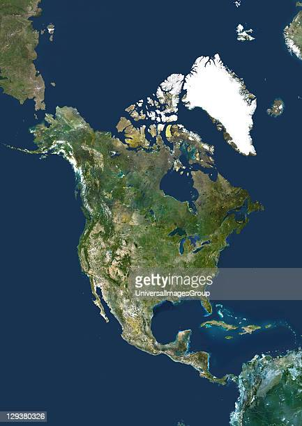 North America True colour satellite image centred on North America The North Pole is at top centre Water is blue vegetation is green arid areas are...