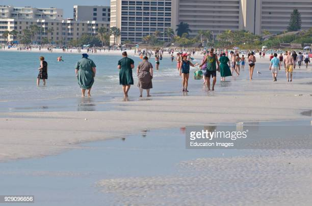 North America, USA, Florida, Sarasota, Crescent Beach Siesta Key Beach Walkers.