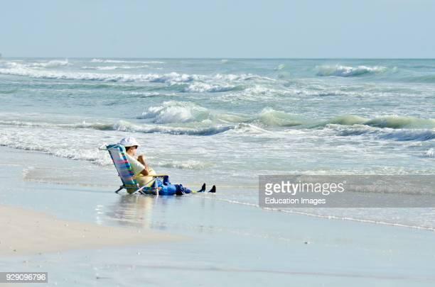 North America, USA, Florida, Sarasota, Crescent Beach Siesta Key, Man Resting in the surf.