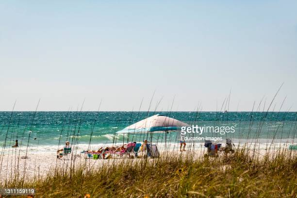 North America, USA, Florida, Sarasota, Crescent Beach, Siesta Key, Relaxing with Shade Devices.