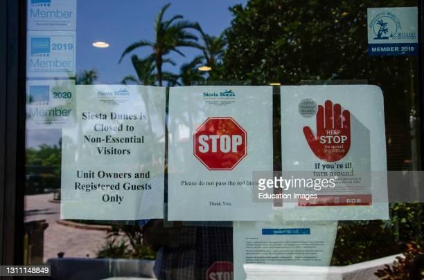 North America, USA, Florida, Sarasota, Crescent Beach, Siesta Key, Siesta Dunes Condominium Caution Signs.