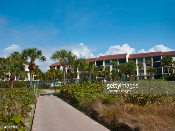 North America, USA, Florida Sarasota, Siesta Key, Crescent Beach. Walkway, Siesta Dunes Condominiums.