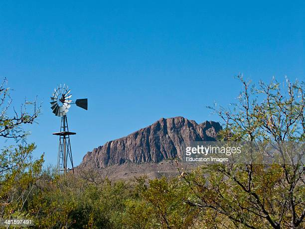 North America, USA, Texas, Big Bend National Park, Chisos Mountains, Nugent Mountain, Dugout Wells Windmill in Foreground.
