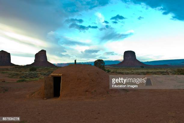 North America USA Utah Gouldings Navajo Tribal Park Monument Valley Hogan and Sweat lodge Framed by Gray Whiskers and Mitchell Butte