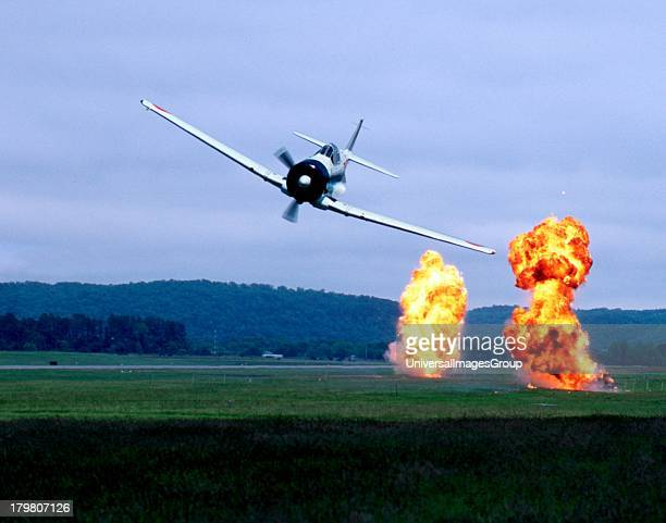 North America USA Wisconsin Bay City Red Wing Airport Japanese Zero Replica performing Tora Tora Tora low level flyover with pyrotechnics at...