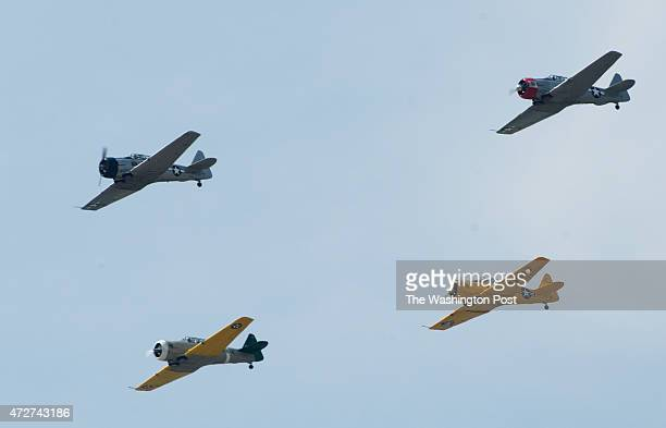 North American AT6 Texans fly in trainer formation it' all part of a World War II planes fly over the National Mall to makr the 70th anniversary of...