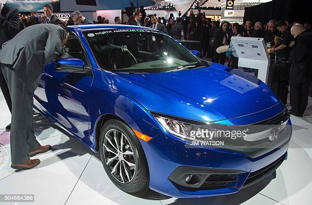 North American Car of the Year, the Honda Civic, on display during the Honda press conference at the North American International Auto Show in...