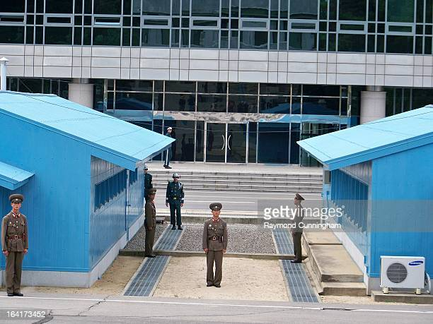 CONTENT] North and South Korean Soldiers from the North Korean side of the DMZ