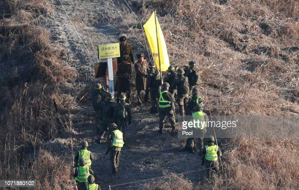 North and South Korean soldiers shakes hands at the Military Demarcation Line between South and North Korea during a mutual onsite verification of...