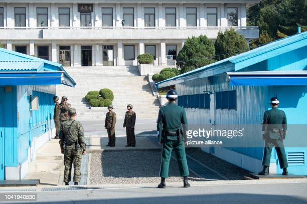 North and South Korean soldiers stand along the border in the demilitarized zone in Panmunjom South Korea 01 November 2014 Photo...