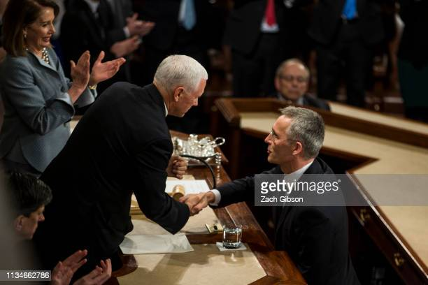 North Atlantic Treaty Organization Secretary General Jens Stoltenberg shakes hands with Vice President Mike Pence as he concludes an address to a...