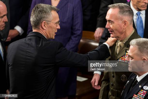 North Atlantic Treaty Organization Secretary General Jens Stoltenberg speaks to Chairman of the Joint Chiefs of Staff Joseph Dunford as he departs...