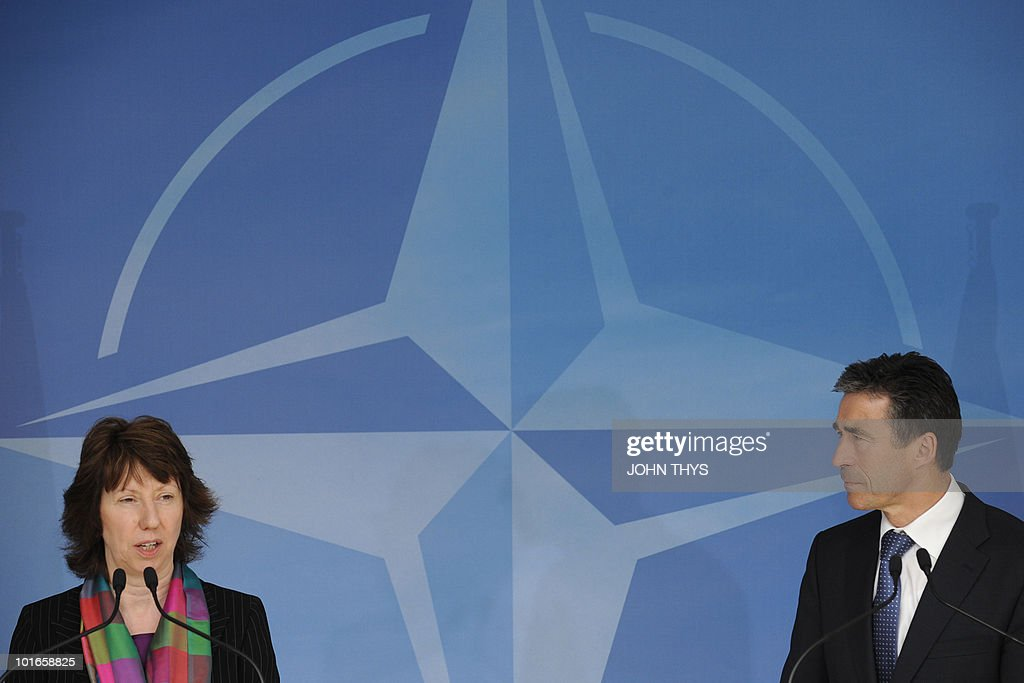 North Atlantic Treay Organization (NATO) Secretary-General Anders Fogh Rasmussen (R) and EU foreign affairs chief Catherine Ashton (L) arrive on May 25, 2010 for a press conference after their bilateral meeting at NATO headquarters in Brussels.