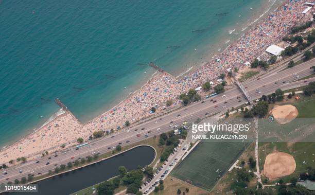 North Avenue beach is seen from the United States Army Parachute Team Golden Knights flight during 60th Annual Chicago Air and Water Show on August...