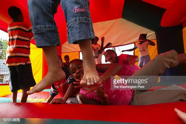 182210 Family Fun Day at the 100th Anniversary of First Baptist Church of North Brentwood PICTURED Children jump in an inflated house during the...