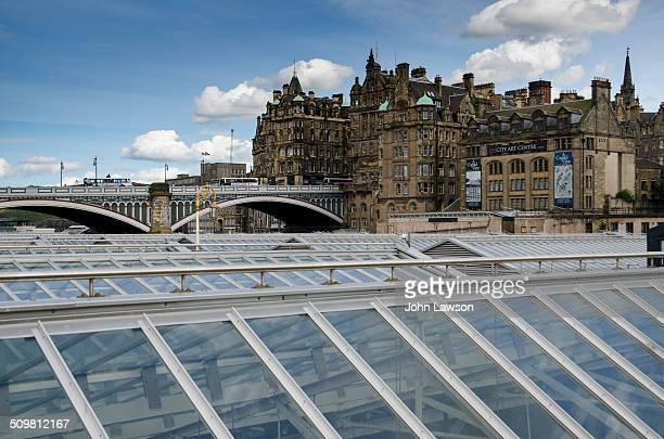 North Bridge in Edinburgh, Scotland viewed over the new roof of Waverley Station. The buildings on North Bridge and Market Street can be seen in the...