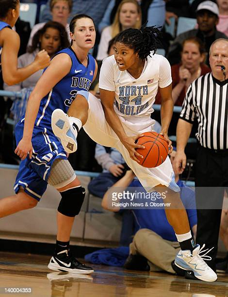North Caorlina guard Tierra RuffinPratt grabs a rebound from Duke forward Haley Peters during the first half at Carmichael Arena in Chapel Hill North...