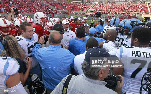 North Carolina and NC State players are separated after the Tar Heels' victory over the Wolfpack 2719 at CarterFinley Stadium in Raleigh North...
