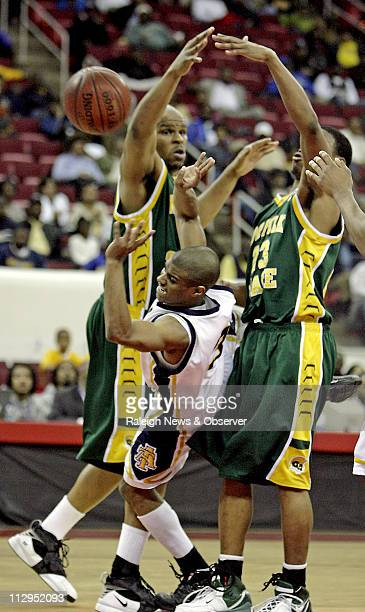 North Carolina AT's Austin Ewing finds it tough going as he tries to squeeze between Norfolk State's Calvin Brown and Corey Lyons during the second...