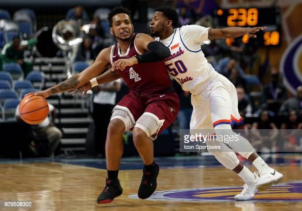 North Carolina Central Eagles guard Jordan Perkins in action against Savannah State Tigers guard Khalen Pinkett during a quarterfinal match between...