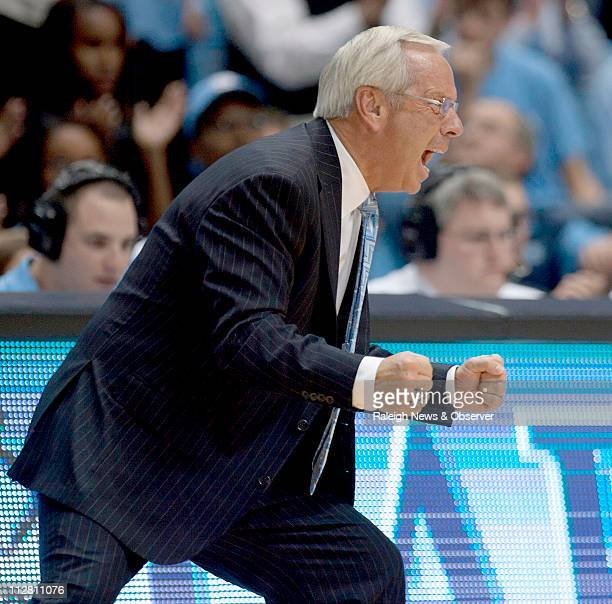North Carolina coach Roy Williams fires up his players as they trailed College of Charleston by three points in the second half on Sunday November 28...