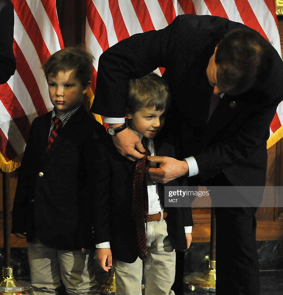 North Carolina Congressman Robert Pittenger adjusts one of his grandsons' tie before the swearing-in ceremony with Speaker John Boehner Speaker on Thursday, January 3, 2013, in Washington, D.C.