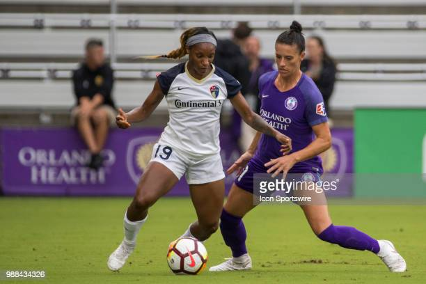 North Carolina Courage forward Crystal Dunn and Orlando Pride defender Ali Krieger go for the ball during the soccer match between the Orlando Pride...
