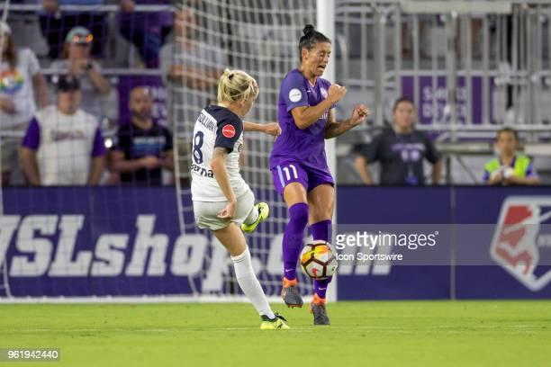 North Carolina Courage midfielder Denise O'Sullivan takes a shot on goal and it is blocked by Orlando Pride defender Ali Krieger during the soccer...