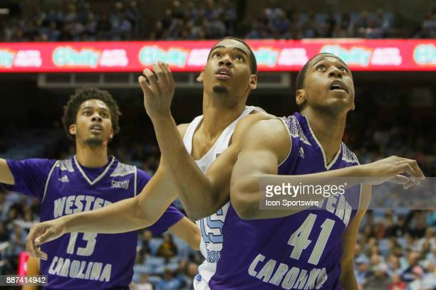 North Carolina forward Garrison Brooks and Western Carolina forward Charlendez Brooks fight for the rebound during the game between the North...