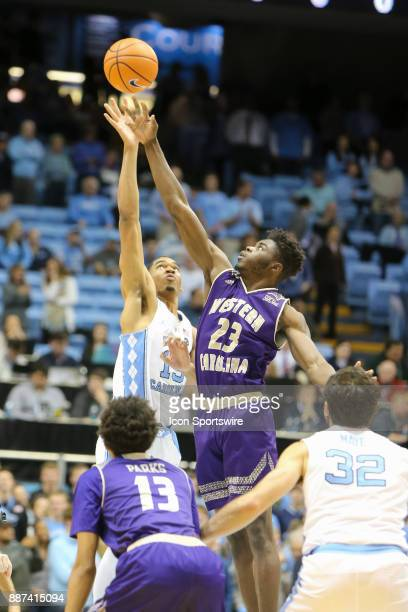 North Carolina forward Garrison Brooks and Western Carolina forward Mike Amius reach for the tip off during the game between the North Carolina Tar...