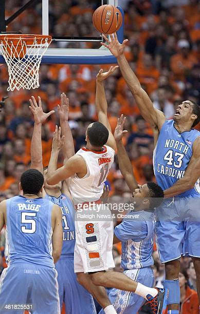 North Carolina forward James Michael McAdoo blocks a shot by Syracuse guard Tyler Ennis' in the second half at the Carrier Dome in Syracuse NY...
