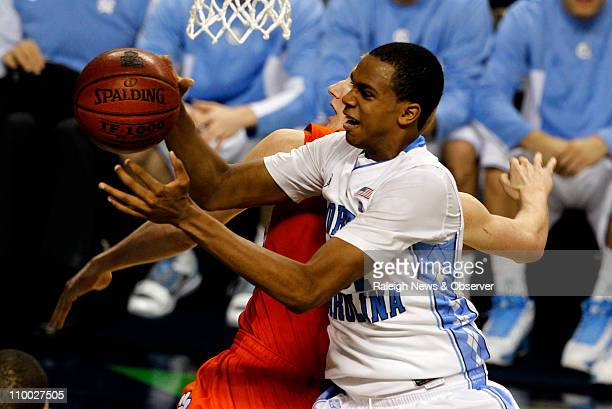 North CArolina forward John Henson grabs a rebound over Clemson guard Tanner Smith during the second half in the semifinals of the ACC Tournament at...