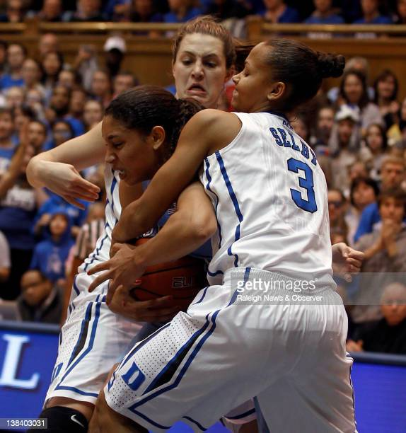 North Carolina forward Krista Gross center gets tied up with Duke guard Shay Selby and forward Haley Peters during the first half at Cameron Indoor...