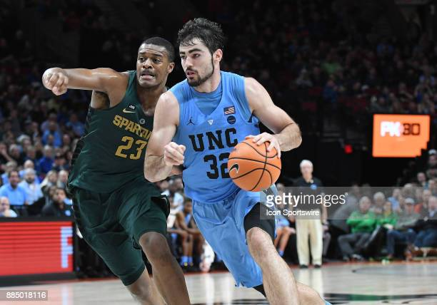 North Carolina forward Luke Made drives the lane against Michigan State forward Xavier Tillman in the championship game of the Victory Bracket at the...
