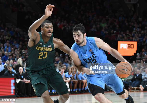 North Carolina forward Luke Made drives to the basket against Michigan State forward Xavier Tillman in the championship game of the Victory Bracket...