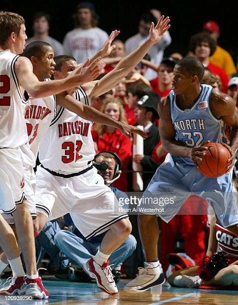 North Carolina forward Rashad McCants is hounded by Ian Johnson Terrell Ivory and Brendan Winters during the first half of the Tar Heels 9168 victory...